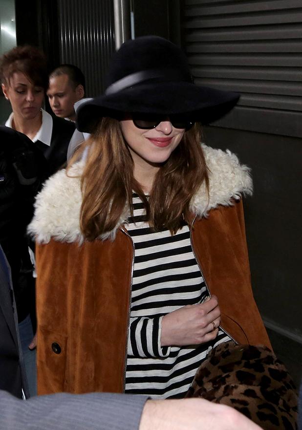 Dakota Johnson sighted arriving at Tegel Airport on February 11, 2015 in Berlin, Germany.