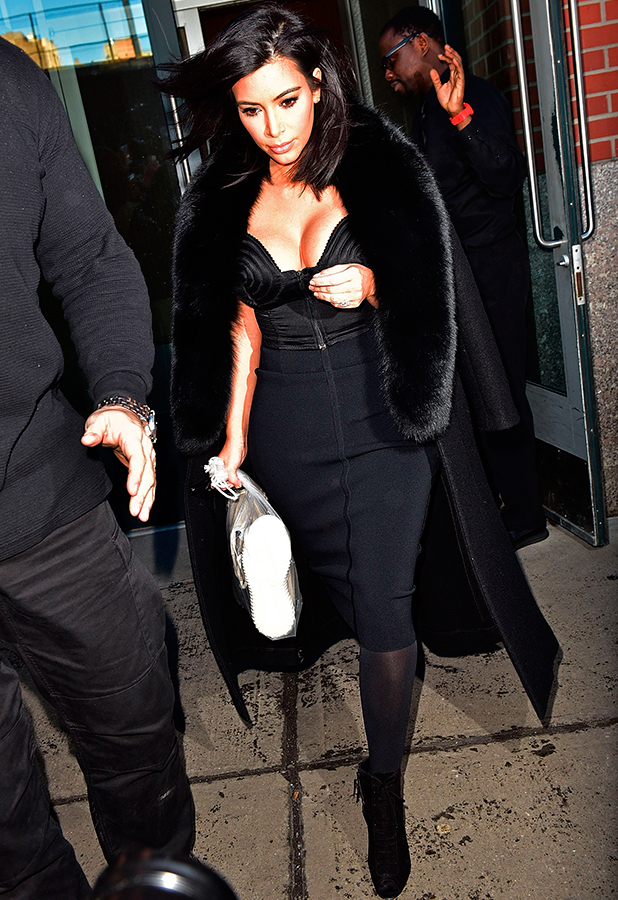 Kim Kardashian and Khloe Kardashian seen on the streets of Manhattan on February 11, 2015 in New York City. (Photo by James Devaney/GC Images)