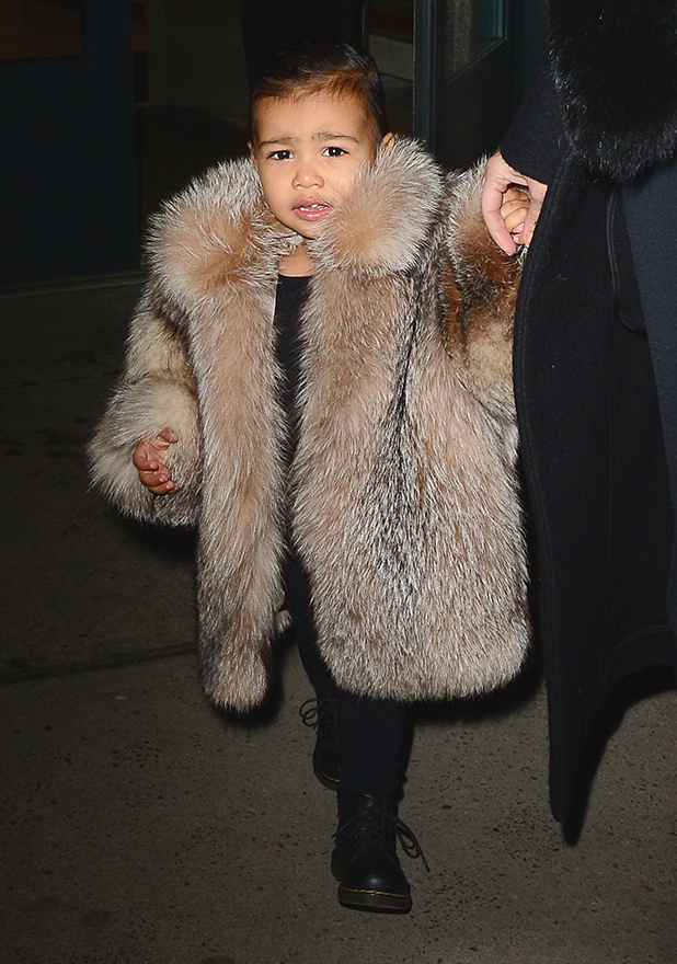 Kim Kardashian and North West are seen in Walking in Soho on February 11, 2015 in New York City.