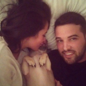 Ricky Rayment and Marnie Simpson cuddle up with his dog Elvis - 16 Feb 2015