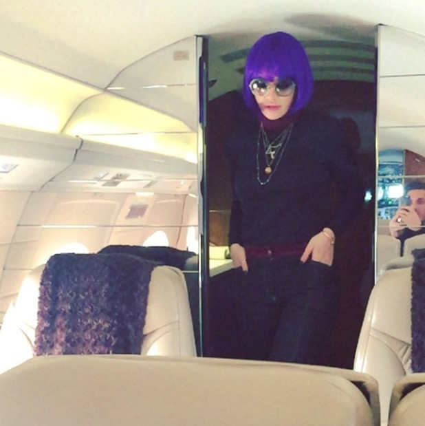 Rita Ora poses in a purple, bobbed wig as she leaves NYFW to head to LA along with hairdresser Chris Appleton and Josie Smith from Global Radio, 16 February 2015