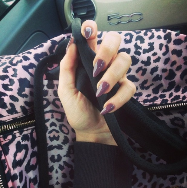 Vicky Pattison shows off fabulous deep purple nails, matching her gym bag! 18 February 2015