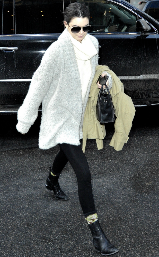 Kendall Jenner out and about in Manhattan wearing an oversized grey cardigan, 17 February 2015