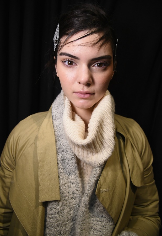 Kendall Jenner prepares backstage at the Vera Wang fashion show during Mercedes-Benz Fashion Week Fall 2015 on February 17, 2015 in New York City.