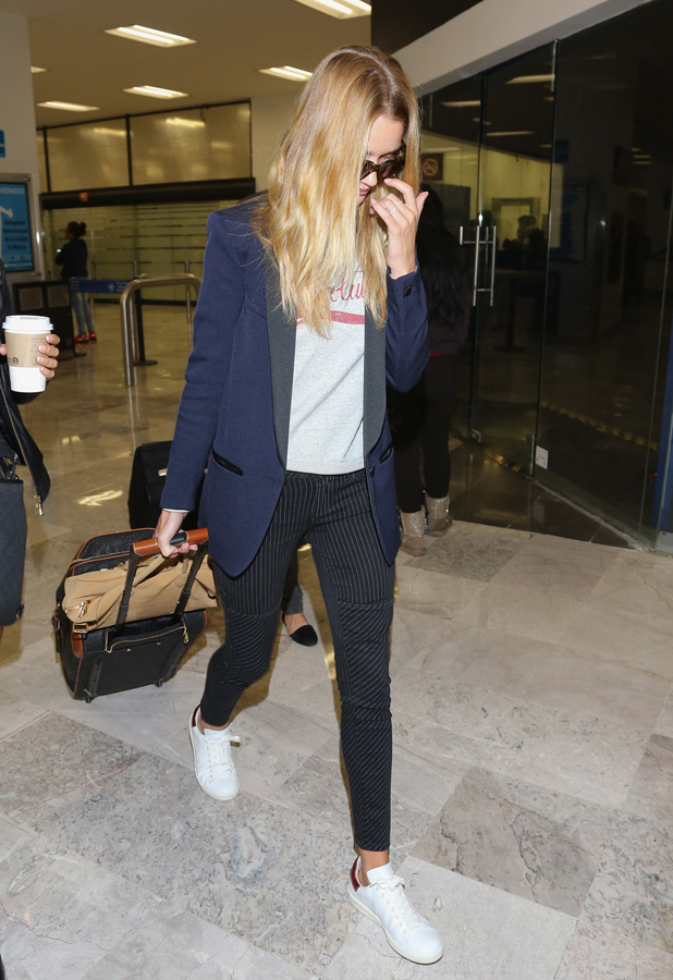 Rosie Huntington-Whiteley at airport on 4 September 2014