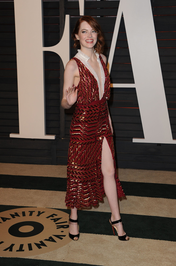Emma Stone opts for revealing red dress at the Vanity Fair Oscars after party (22 February)