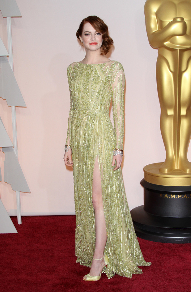 Emma Stone steps out in stunning golden dress at the Oscars (22 February)