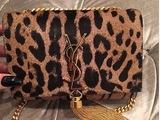 Khloe Kardashian gives us bag envy with her YSL leopard print bag.