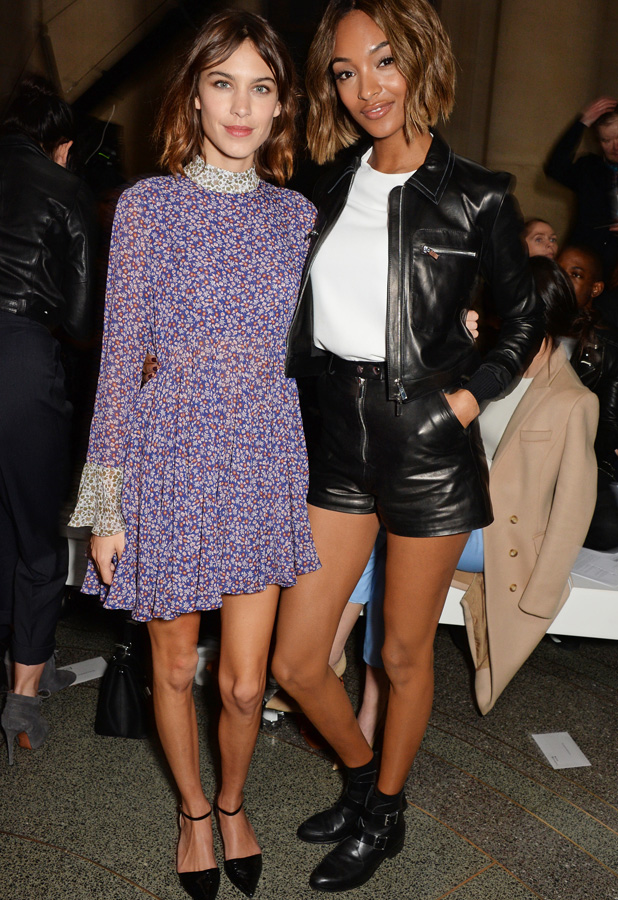 Alexa Chung (L) and Jourdan Dunn attend the Topshop Unique show during London Fashion Week Fall/Winter 2015/16 at Tate Britain on February 22, 2015 in London, England
