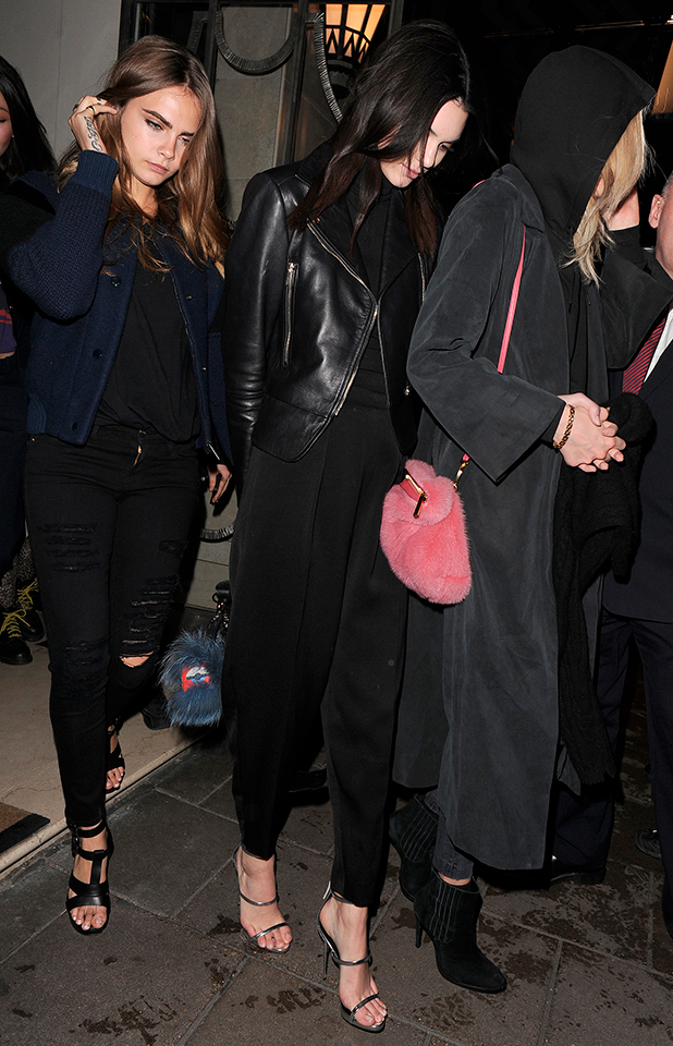 Cara Delevingne and Kendall Jenner attending the Giles AW15 show on February 23, 2015 in London, England.
