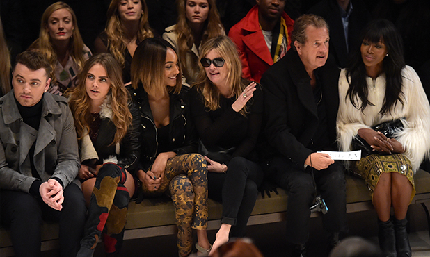 Sam Smith, Cara Delevingne, Jourdan Dunn, Kate Moss, Mario Testino and Naomi Campbell attend the Burberry Prorsum AW 2015 show during London Fashion Week at Kensington Gardens on February 23, 2015 in London, England.