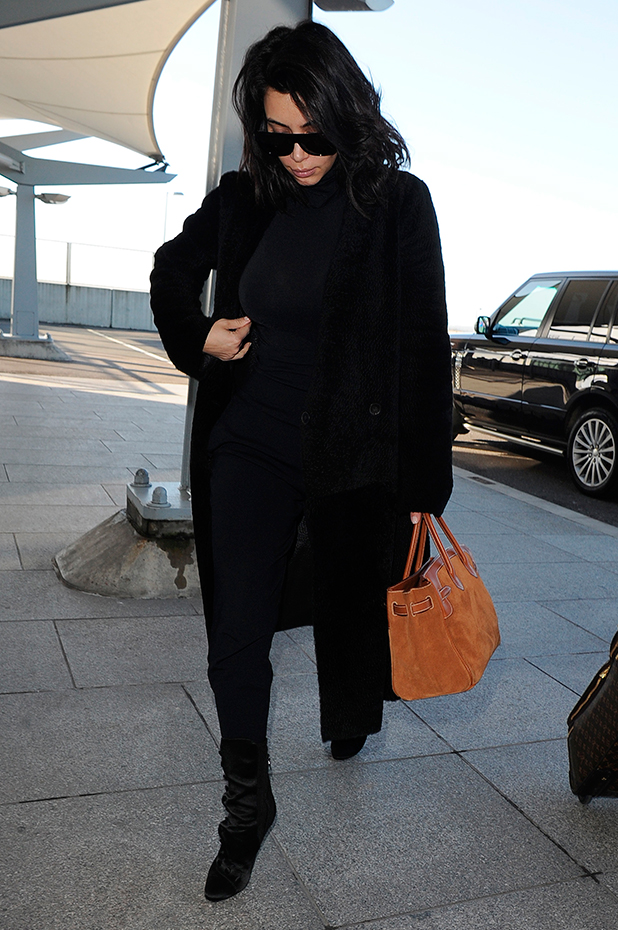 Kim Kardashian arrives at Heathrow Airport alone, to board a flight home to Los Angeles, 27 February 2015