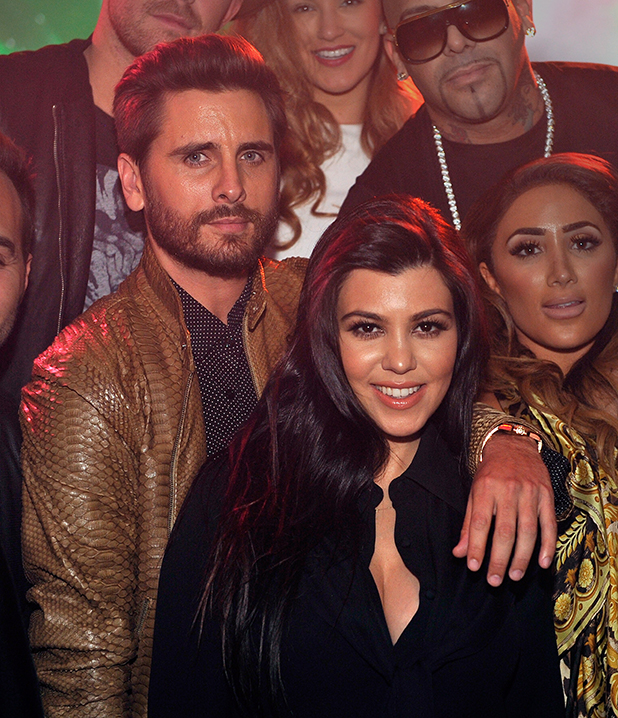 Scott Disick (L) and Kourtney Kardashian appear at 1 OAK Nightclub at The Mirage Hotel & Casino on February 21, 2015 in Las Vegas, Nevada.