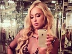 Paris Hilton swaps her holiday wardrobe for glamorous dress