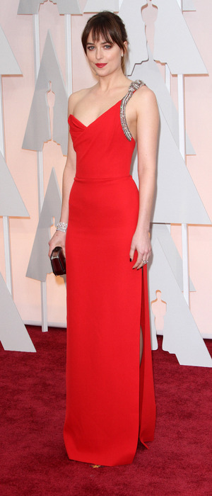 Dakota Johnson dazzles in show-stopping YSL red gown at the Oscars (22 February).