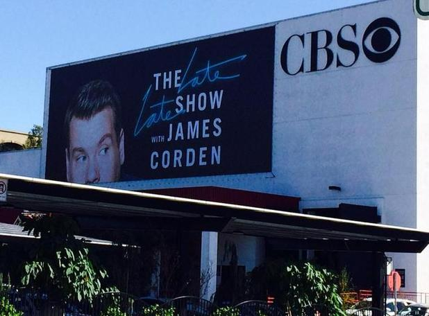 James Corden takes a picture of his Late Late Show billboard at CBS in Los Angeles, 6 March 2015