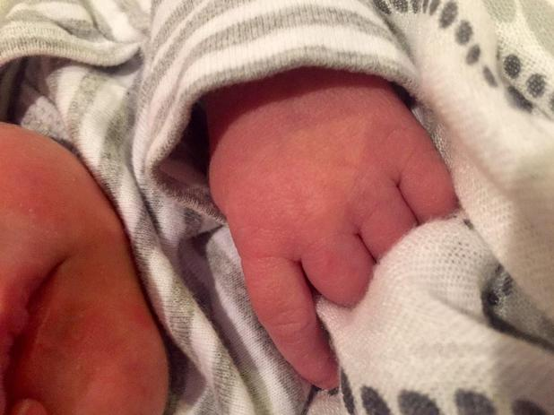 Carrie Underwood shares first photo of her baby boy, Isaiah Michael Fisher. 3 March 2015.