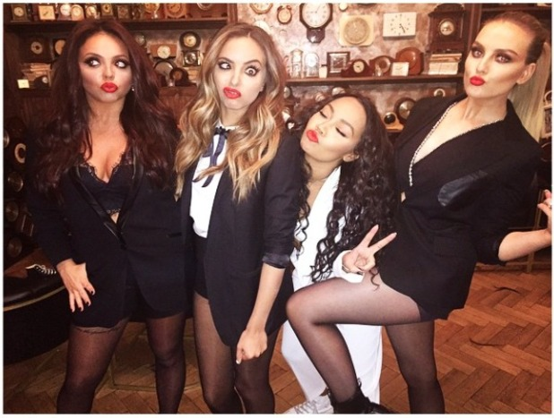 Little Mix messing about before they perform at The Sun Bizarre party, 2 March 2015