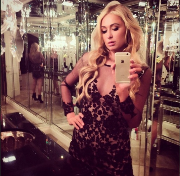 Paris Hilton getting ready to go out in LA, 4/3/15