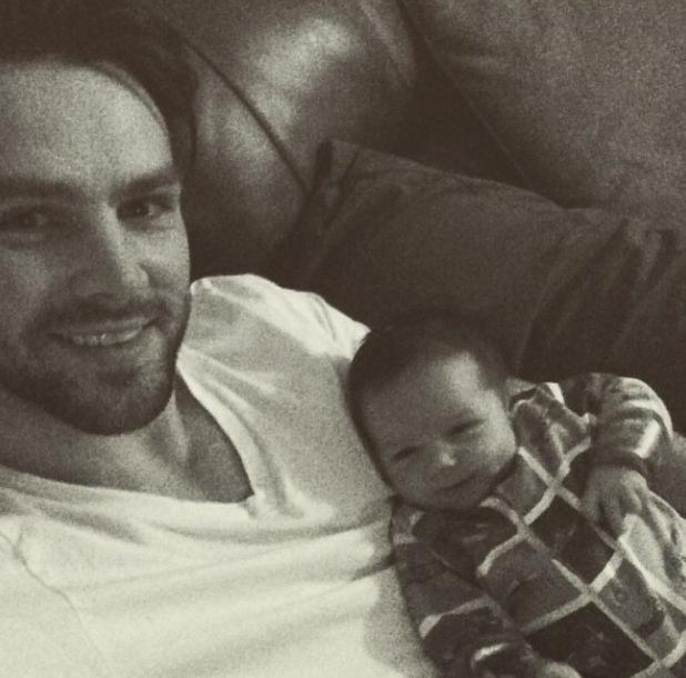Ben Foden cuddles up to newborn son Tadhg - 28 February 2015.