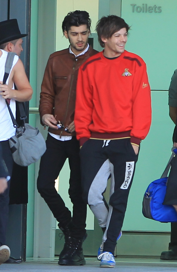 One Direction's Zayn Malik and Louis Tomlinson arrives back in London from the World Tour in Tokyo - 03/03/2015.