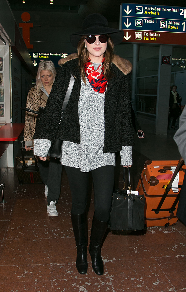 Actress Dakota Johnson is seen at Charles-de-Gaulle airport on March 5, 2015 in Paris, France. (Photo by Marc Piasecki/GC Images)