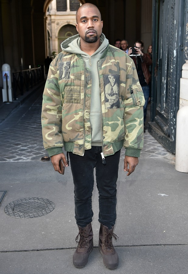 Kanye West arrives at Dries Van Noten fashion show during Paris Fashion Week Fall Winter 2015/2016 on March 4, 2015 in Paris, France.