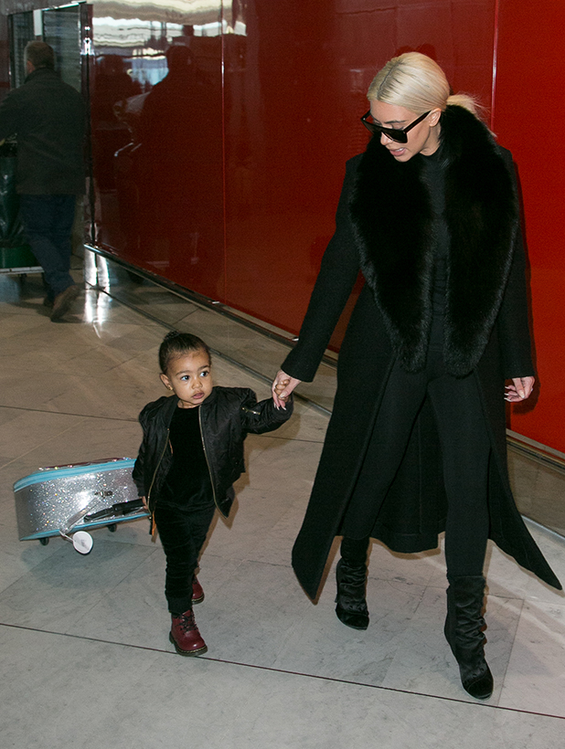 Kim Kardashian West and her daughter North West are seen at 'Charles-de-Gaulle' airport on March 12, 2015 in Paris, France.