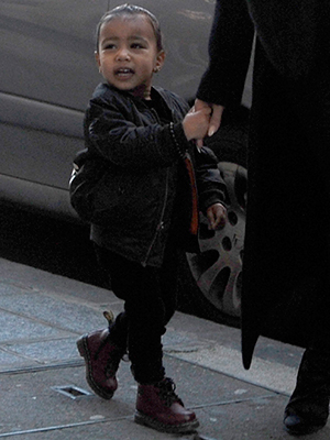 Kim Kardashian holds her daughter North West's hand whilst out in Paris, 12 March 2015