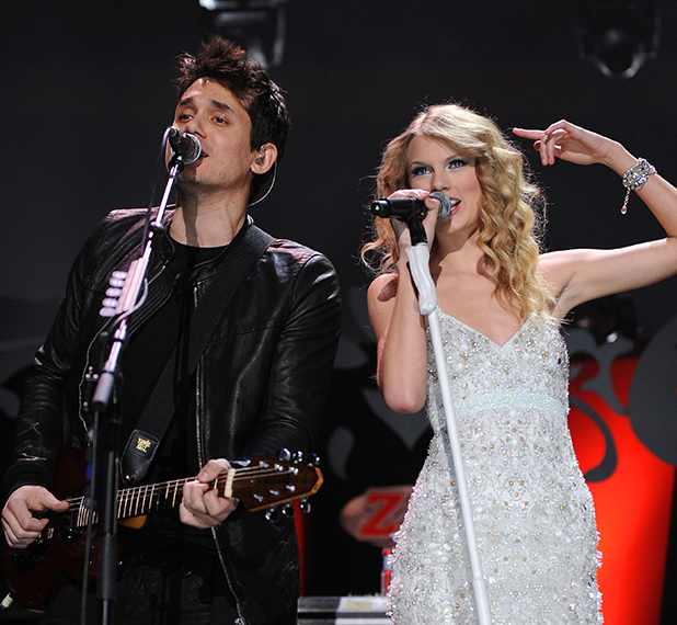 John Mayer and Taylor Swift perform onstage during Z100's Jingle Ball 2009 at Madison Square Garden on December 11, 2009 in New York City.