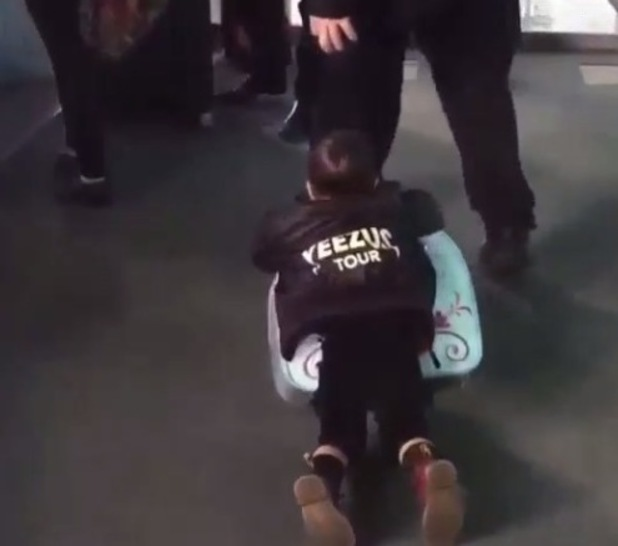 North West holds onto Frozen suitcase at airport - 18 March 2015.