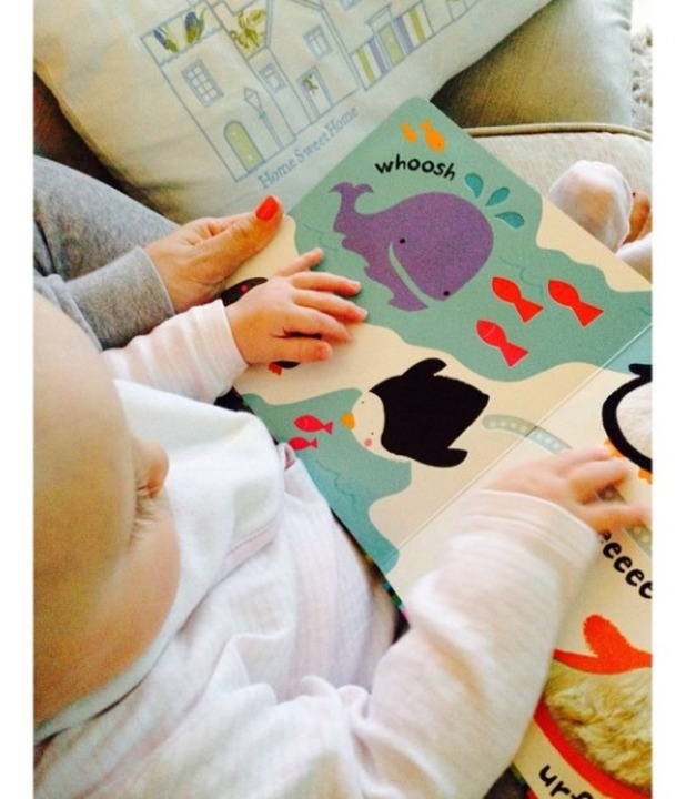 Billie Faiers reads to her daughter Nelly, March 2015.
