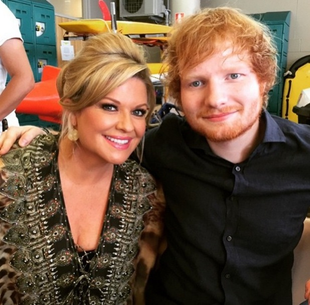 Ed Sheeran grabs a photo with Summer Bay resident Marilyn Chambers in Home & Away - 24 March 2015.