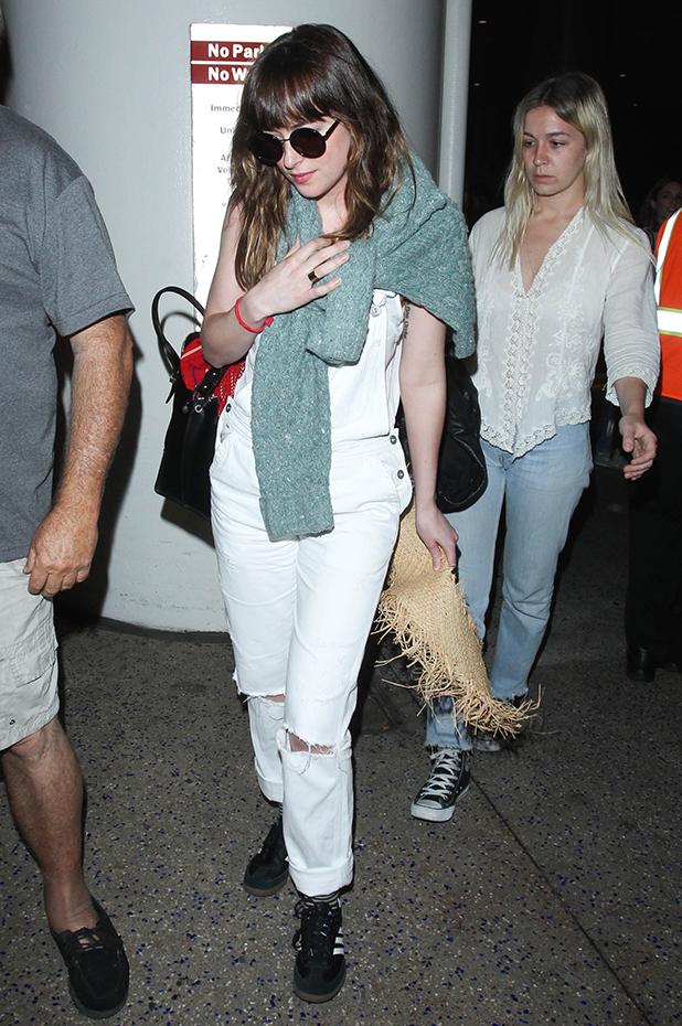 Dakota Johnson seen at LAX on March 21, 2015 in Los Angeles, California.