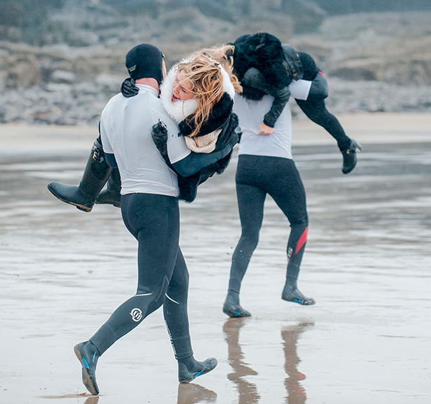 'The Only Way is Essex' cast filming, Porthcawl, Wales, Britain - 23 Mar 2015 (L-R) James Lock carrying Danielle Armstrong, Diags carrying Fran Parman