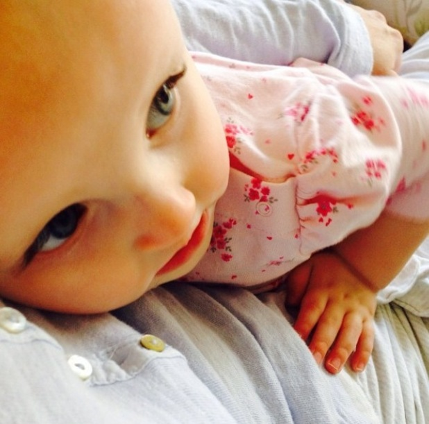 """TOWIE's Billie Faiers enjoys """"afternoon cuddles"""" with baby daughter Nelly - 30 March 2015."""