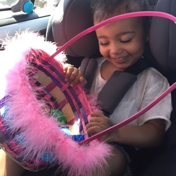 North West goes on a easter egg hunt with mum Kim Kardashian - 30 March 2015.