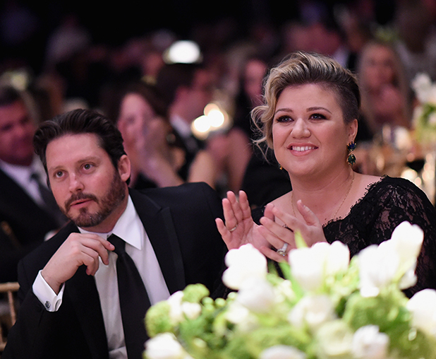 Brandon Blackstock (L) and singer/songwriter Kelly Clarkson attend Muhammad Ali's Celebrity Fight Night XXI at JW Marriott Phoenix Desert Ridge Resort & Spa on March 28, 2015 in Scottsdale, Arizona.