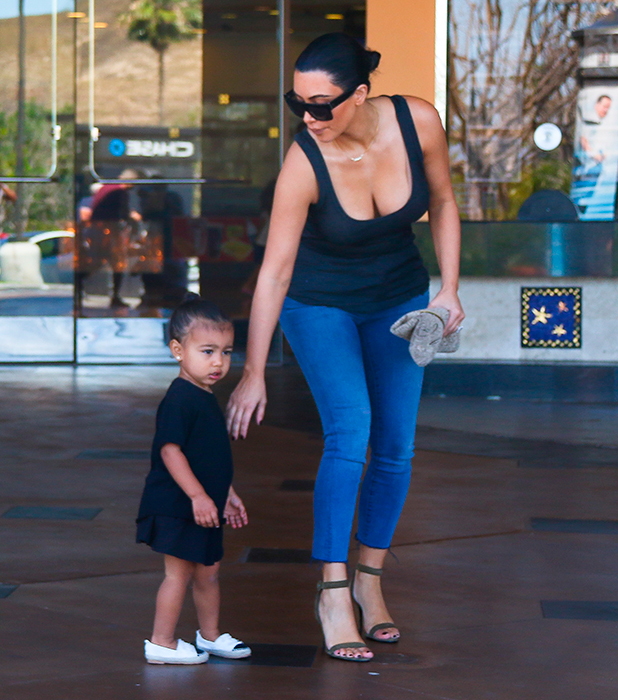 Kim Kardashian and her sister Kourtney Kardashian leave a movie theatre in Calabasas after taking their children to watch 'Cinderella' 28 March 2015