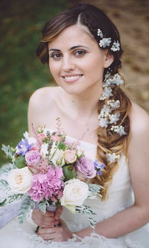 Bride on her wedding day with a bouquet of flowers