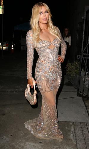 Paris Hilton arrives at the launch of Charbel Zoe boutique, LA 7 April