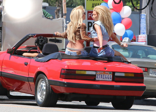 Britney and Iggy ride round in red convertible
