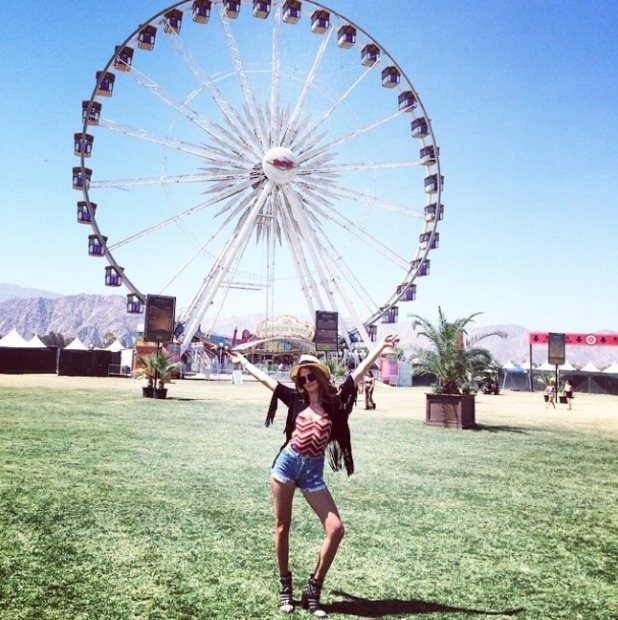 Millie Mackintosh poses in front of the big wheel at Coachella 2015, 11 April 2015