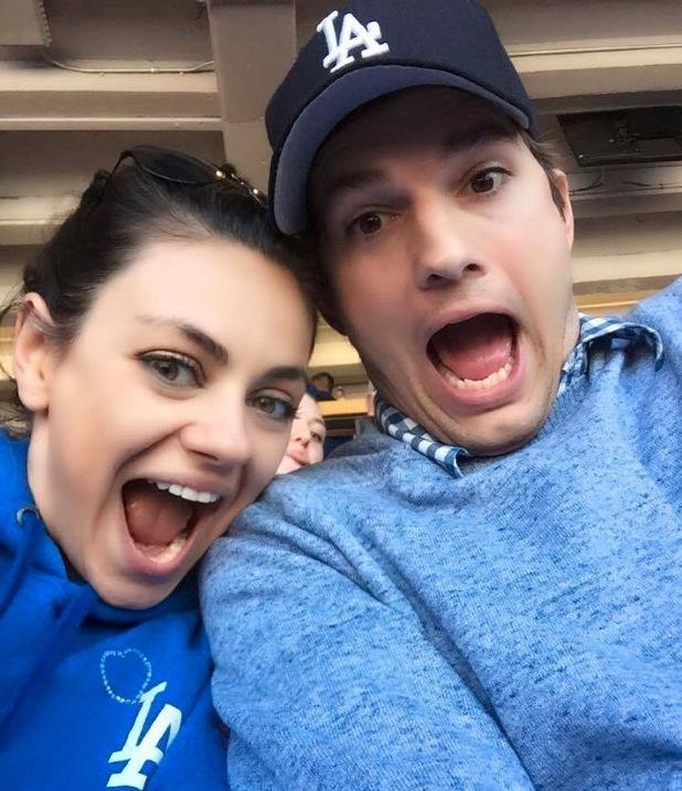 Ashton Kutcher and Mila Kunis at LA Dodgers baseball game, LA 6 April