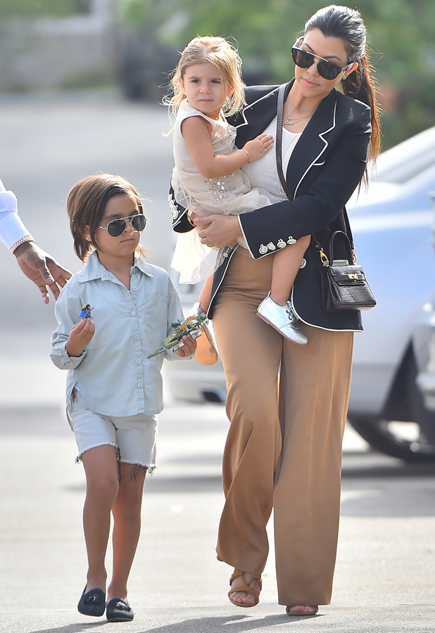 The extended Kardashian-Jenner family attend church in Woodland Hills on Easter Sunday 2015.
