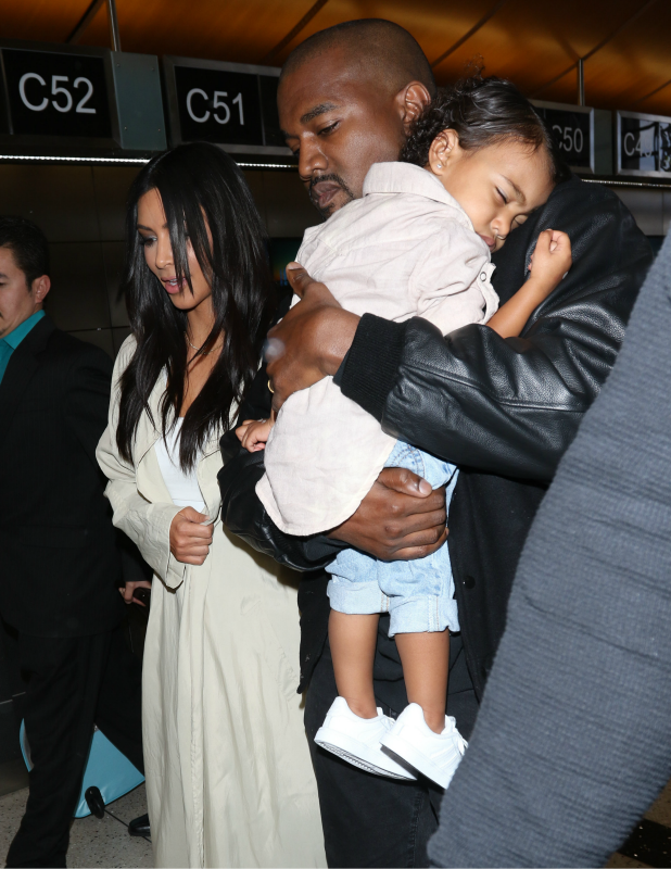 Kanye West, Kim Kardashian and North West are seen at LAX on April 07, 2015 in Los Angeles, California.