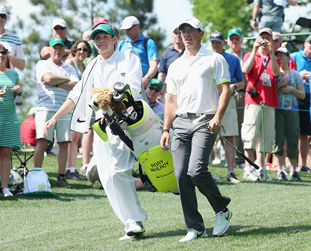Niall Horan of the band One Direction works as a caddie for Rory McIlroy of Northern Ireland during the Par 3 Contest prior to the start of the 2015 Masters Tournament at Augusta National Golf Club on April 8, 2015 in Augusta, Georgia.