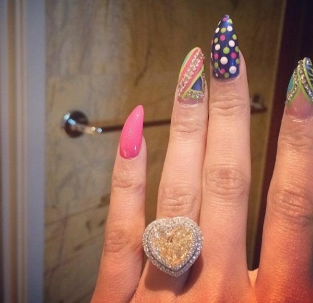 Nicki Minaj shows off heart-shaped engagement ring - 16 April 2015.