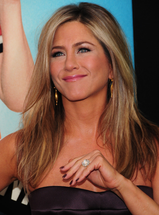Jennifer Aniston shows off her engagement ring on the red carpet