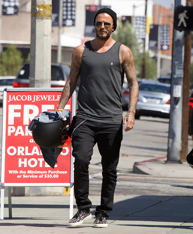 David Beckham stops off for a health shake with a friend on 3rd street in West Hollywood. He then drove off on his motorcycle, 13 April 2015